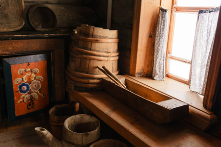 fragment of the interior of an old peasant log cabin - wooden household items and hand painted homemade buffet Imagens