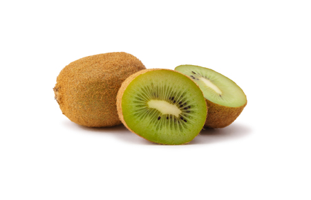 three ripe kiwi fruit (two of them cut) close up on white background 写真素材