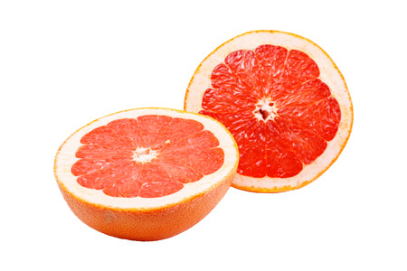 two halves of pink grapefruit isolated on white background 写真素材