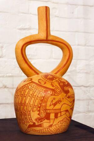 Yekaterinburg, Russia - January 17, 2019: ancient Peruvian ceramic vessel depicting anthropomorphic birds or birdlike men, Moche culture, AD 500-700