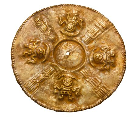 Yekaterinburg, Russia - January 17, 2019: golden disc of ancient Peruvian Chimu culture with images of the god Ai Apaeс, AD 1100-1470