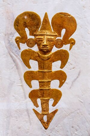Yekaterinburg, Russia - January 17, 2019: golden pendant depicting a shaman as a crustacean from Uraba, Colombia, AD 800