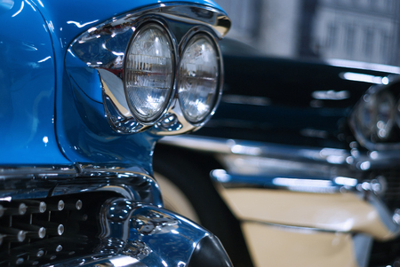 fragment of the front of a blue vintage luxury car