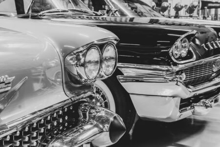 Yekaterinburg, Russia - January 16, 2019: front parts of vintage cars standing at exhibition, monochrome retro style photo