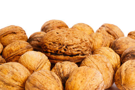 heap of walnuts, one of which is more than the others, on a white background 写真素材