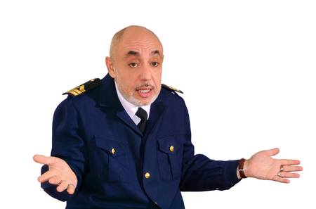 elderly man in an officer's sea uniform shrugs in a gesture