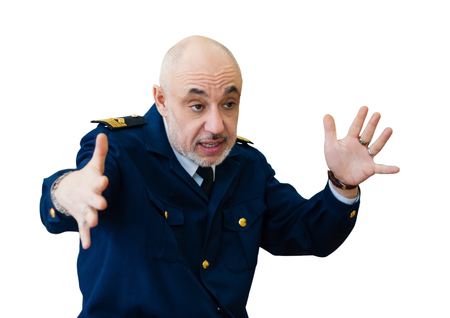 elderly man in an officer's sea uniform emotionally narrates something, gestures something big; isolated on white background Banco de Imagens