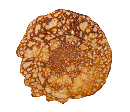 thin homemade uneven golden crispy pancake isolated on a white background Stockfoto