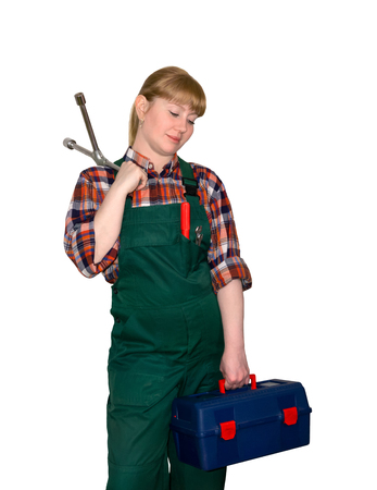 female auto mechanic in bib overalls with spider-type lug wrench and toolbox, looking down, isolated on white background