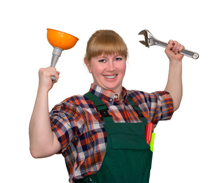 young woman with a small plunger and an adjustable wrench in a triumphant pose smiling isolated on a white background Фото со стока - 121112346