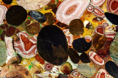 background - a natural multi-colored stone, a conglomerate of jasper and agate Stock fotó