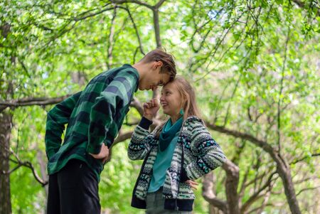 two teenagers communicate and argue outdoor in the park 写真素材