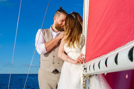 newlyweds in a wedding trip to the sea on a sailing yacht