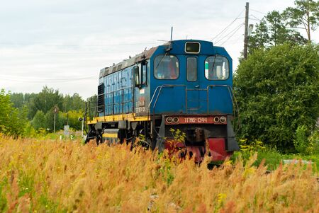 Yekaterinburg, Russia - July 10, 2019: shunting locomotive TGM6 on a railway line among the forest and field