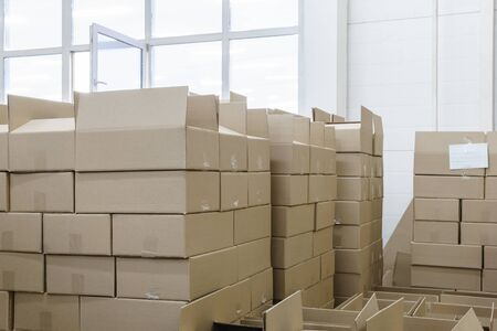 stacks of cardboard boxes with products in the packaging workshop