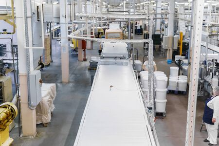 work in the workshop of a modern automated confectionery factory with conveyor lines