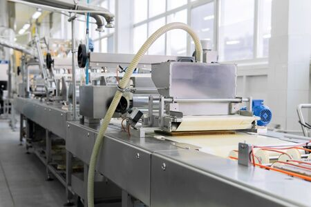 automated chocolate wafer baking production line at a confectionery factory