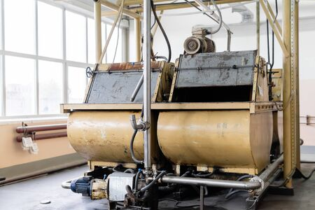old conche machine with electric motor in the shop of a confectionery factory