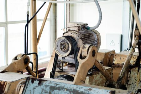 fragment of an old conche machine with electric motor in the shop of a confectionery factory