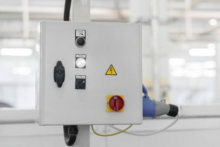 control unit of some production line or machine on a blurred background of the interior of the workshop Stok Fotoğraf