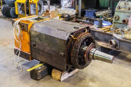 disassembled large industrial electric motor in the repair process in the workshop