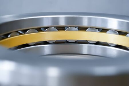 blurred industrial background with a fragment of a roller bearing close-up Imagens