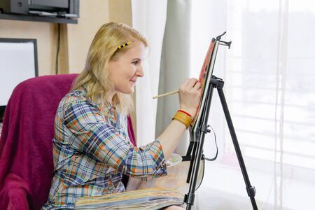 woman painter draws a sketch illustration and smiling