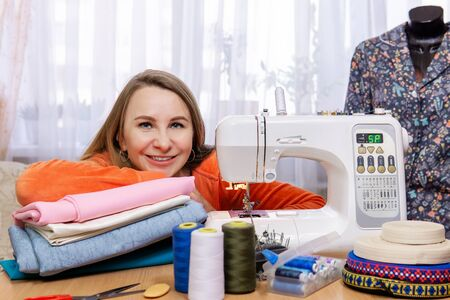 portrait of a woman with a sewing machine at her home Reklamní fotografie