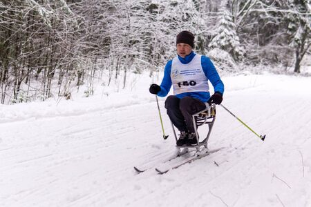 Perm, Russia - December 07, 2019: disabled athlete during a cross-country race at a forest ski run in regional competitions