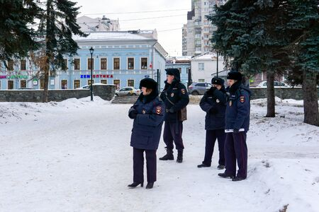 Perm, Russia - December 14, 2019: police officers keep order in a winter park