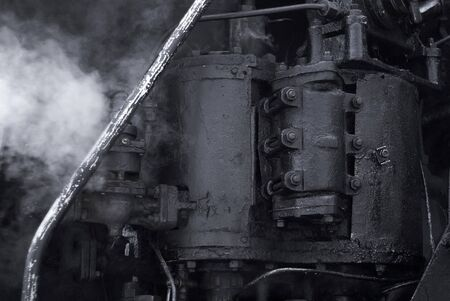 black industrial background - fragment of a working vintage steam engine Stock Photo