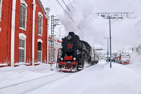 Perm, Russia - February 01, 2020: vintage steam locomotive passing through Perm-1 station