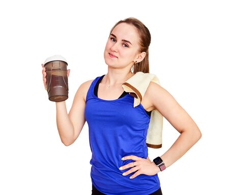 graceful athletic woman with a towel and a shaker bottle for sports drink after workout, isolated on white background Standard-Bild