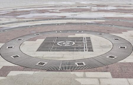sidewalk grates for water drainage - part of the hydraulic system of a modern fountain Archivio Fotografico