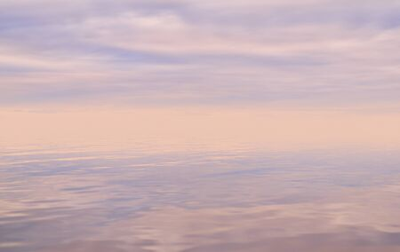 sky reflected in water, colored background, misty sea landscape in pastel colors