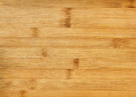 wooden background - pressed bamboo fiber board close up