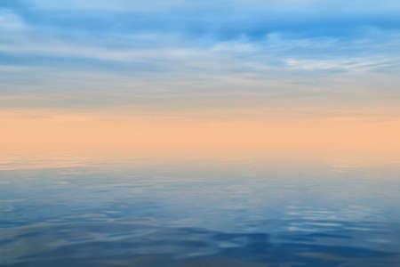 background, landscape - blue water and sky, the horizon is hidden by a gentle beige dawn haze