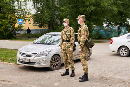 Perm, Russia - July 01, 2020: cadets of the Russian Guard (Special Forces of the Internal Troops of the Ministry of Internal Affairs) were brought in to protect order at a polling station during an outbreak of coronavirus infection