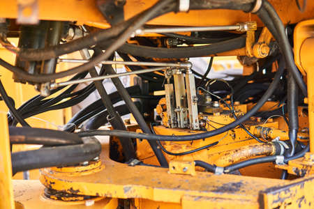 industrial background - construction details of the articulated steering of a heavy bucket loader