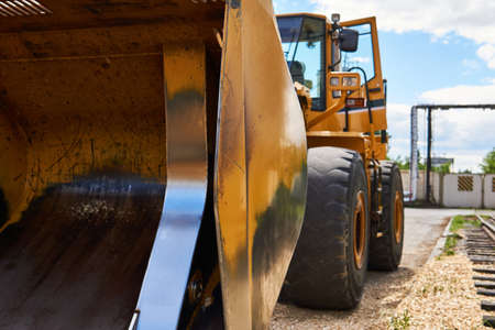 standing heavy construction wheeled bulldozer close up