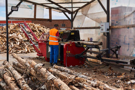 Perm, Russia - May 29, 2020: modern firewood processor in operation Editorial