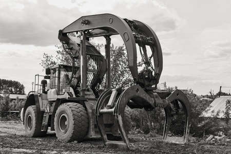 dual function grapple skidder stands on the ground outdoors Stockfoto