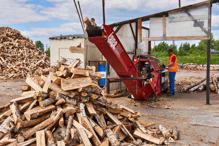 Perm, Russia - May 29, 2020: modern firewood processor in operation Banco de Imagens