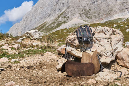saddler's temporary workplace outdoor in the mountains during the summer grazing season in highland pastures in the Caucasus, Russia