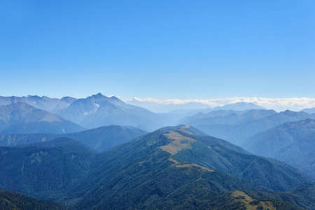 view from the top of Mount Oshten to the distant ranges of the Caucasus Mountains in a blue haze Stock fotó