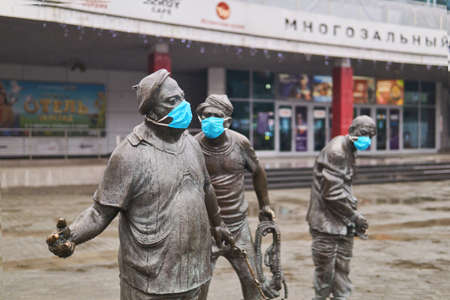 Perm, Russia - November 07, 2020: surgical masks are worn on monument to the famous comedians Vitsin, Nikulin and Morgunov (by Alexey Zalazayev) as an act of street art during the COVID-19 pandemic