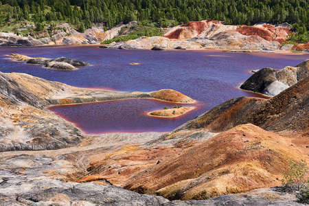 strange purple lake formed on the site of an old kaolin quarry 版權商用圖片