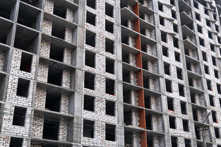 background - a wall of a multi-storey building under construction