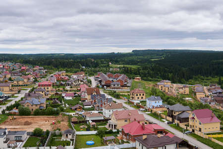 suburban neighborhood currently under development with private houses at the edge of the forest 版權商用圖片