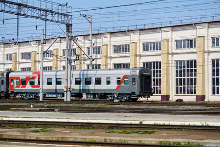 Perm, Russia - August 07, 2020: passenger cars on shunting tracks against the background of the depot building Redakční